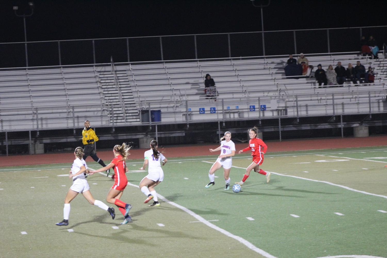 Freshman Ashley Pugh races to steal the ball.