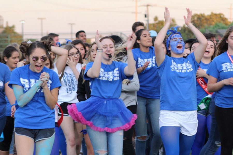 Seniors show their spirit during the night rally.