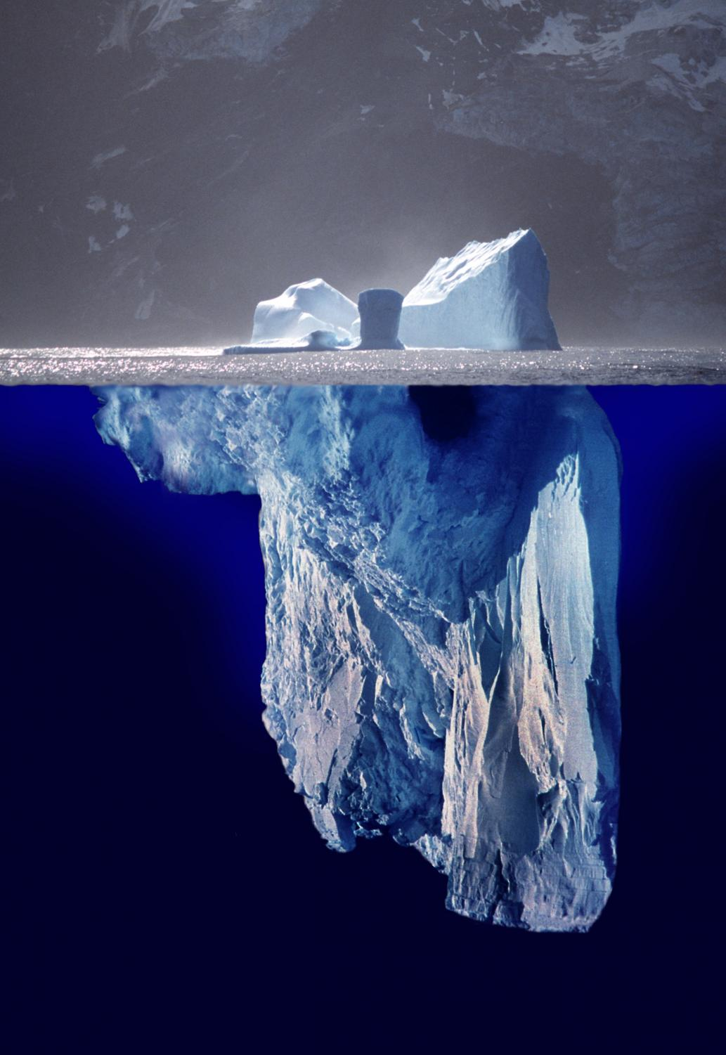 The tip of an iceberg is a small, unrepresentative portion of something much larger or deeper that can't be seen or understood.