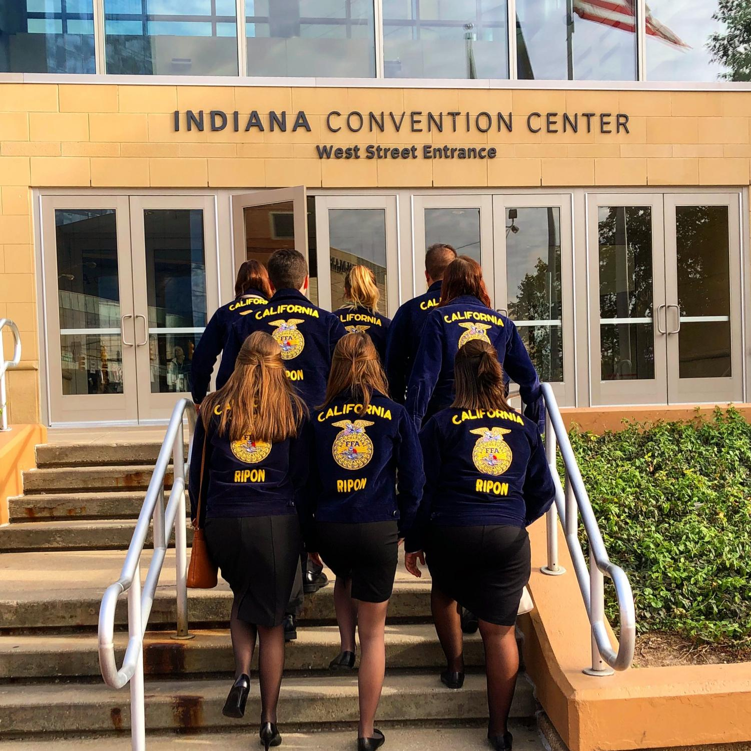 Back row, left to right: Maddie Hoogendorn, Kayla Keating, Stephen Defreitas. Middle row, left to right: Ean Richards, Megan Harlan. Front row: Nicole Powell, Macie McPeak, Kaitlyn Avila.  Students walk up to the Indiana Convention Center on their way to many activities at National Convention.