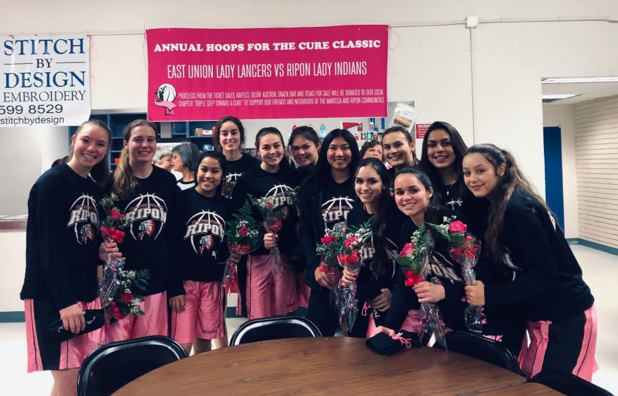 Pictured+above%2C+the+Girls+Varsity+Basketball+team+for+Ripon+High+posed+with+a+few+of+their+cancer+survivors+and+roses.+