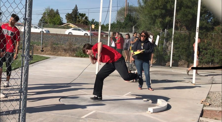 Otto+Kellner+begins+to+throw+in+his+shot+put+event.